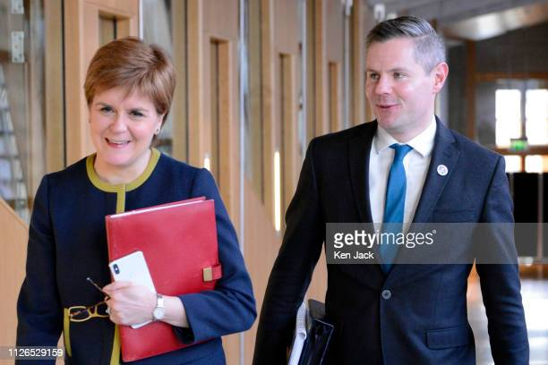 Scottish Finance Secretary Derek Mackay on the way to open the Stage 3 budget debate in the Scottish Parliament accompanied by First Minister Nicola...