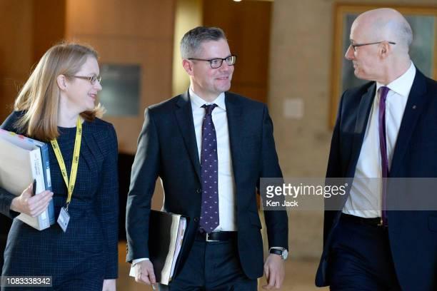 Scottish Finance Secretary Derek Mackay on the way to the chamber of the Scottish Parliament accompanied by Deputy First Minister John Swinney and...