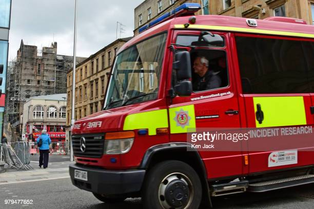 Scottish Fire Service Incident Research and Investigation vehicle drives close to the Glasgow School of Art Mackintosh building which was completly...