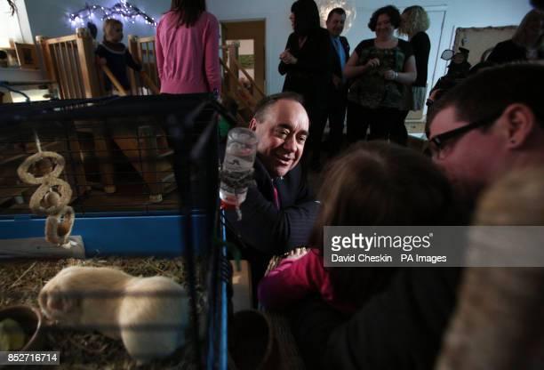 Scottish First Minister Alex Salmond talks to chidren and staff during a visit to the Under 5s Nursery in Edinburgh's city centre