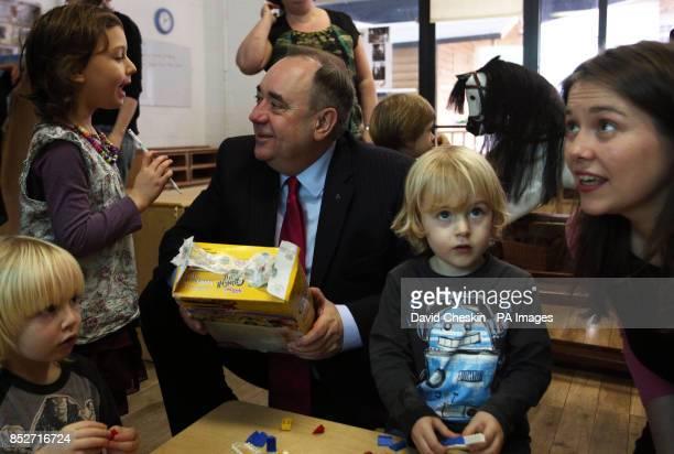 Scottish First Minister Alex Salmond talks to children during a visit to the Under 5s Nursery in Edinburgh's city centre