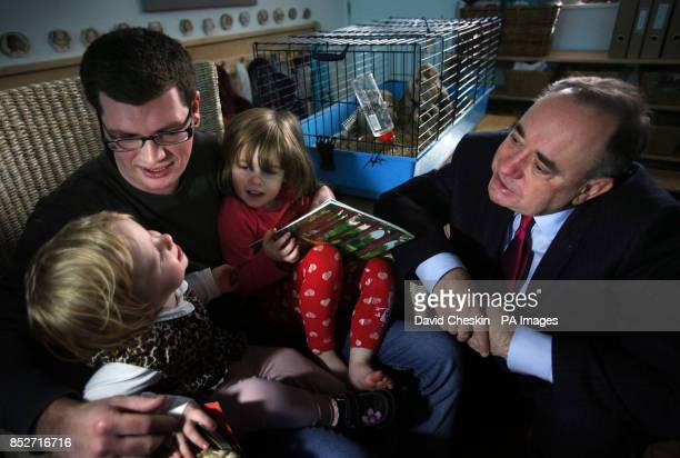 Scottish First Minister Alex Salmond talks to staff member Scot Taylor during a visit to the Under 5s Nursery in Edinburgh's city centre