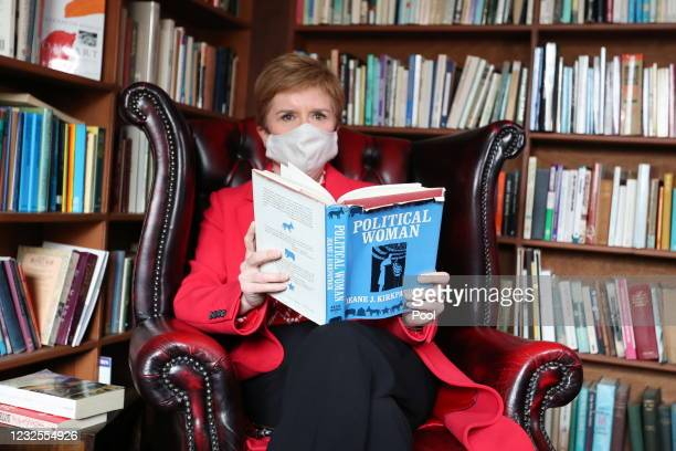 """Scottish First Minister and leader of the Scottish National Party Nicola Sturgeon looks at a book entitled """"Political Women"""" as she visits the..."""