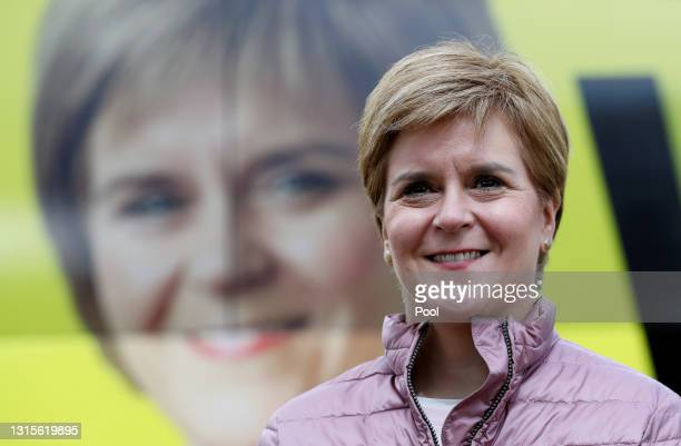 Scottish First Minister and leader of the Scottish National Party Nicola Sturgeon poses in front f her campaign bus as she visits Perth Farmers...