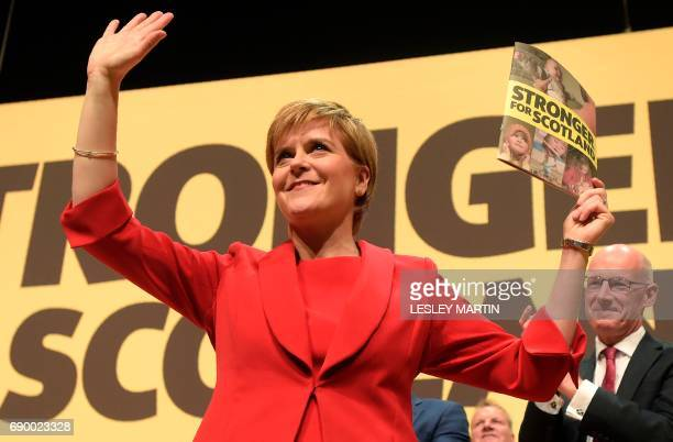 Scottish First Minister and Leader of the SNP Nicola Sturgeon reacts after delivering the Scottish National Party's election manifesto in Perth...