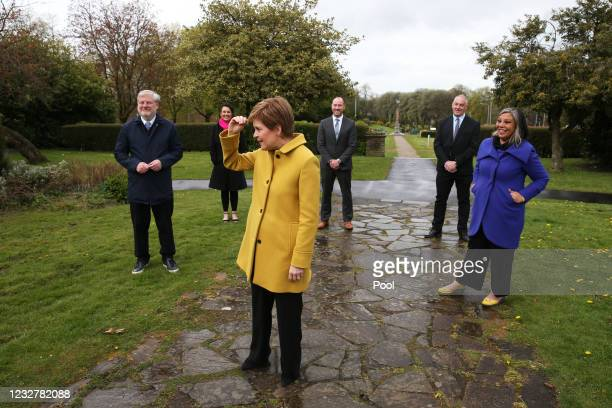 Scottish First Minister and SNP leader Nicola Sturgeon alongside newly elected MSPs during a visit to Airdrie on May 9, 2021 in North Lanarkshire,...