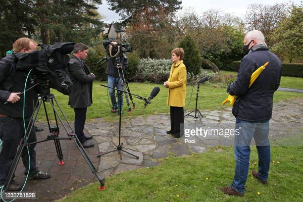 Scottish First Minister and SNP leader Nicola Sturgeon speaks to the media during a visit to Airdrie on May 9, 2021 in North Lanarkshire, Scotland....