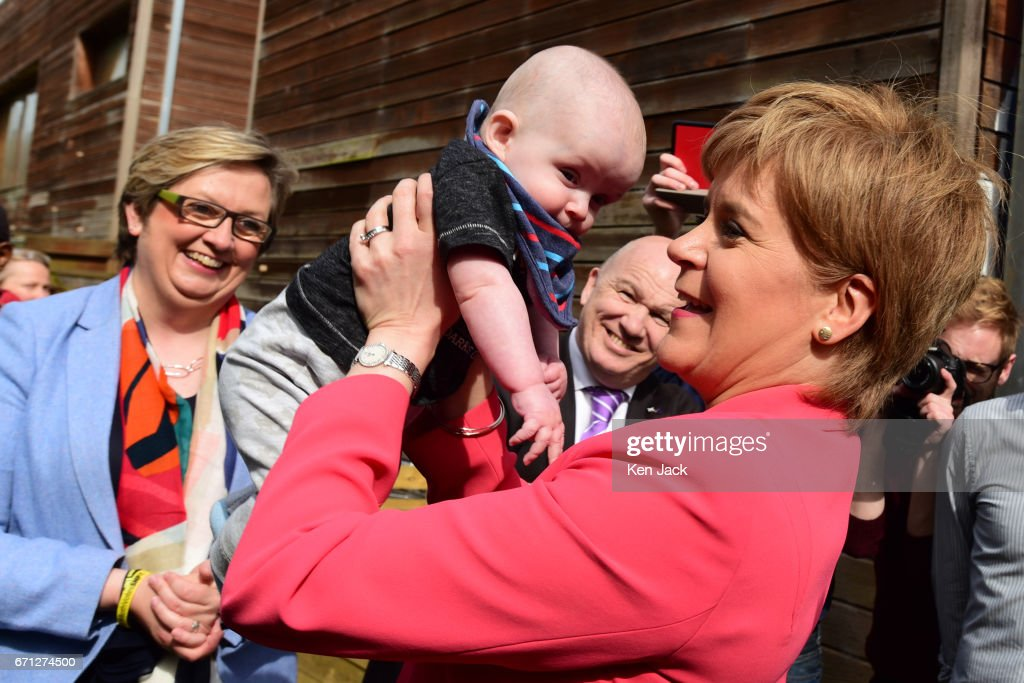 Scottish First Minister and SNP leader Nicola Sturgeon with six-month old Ollie Lynch from Edinburgh, as she launches the party's manifesto for the local government elections campaign at WHALE community arts centre, with Joanna Cherry MP and Gordon MacDonald MSP in the background, on April 21, 2017 in Edinburgh, Scotland. Local elections are scheduled to take place on Thursday May 4 across all local authorities.