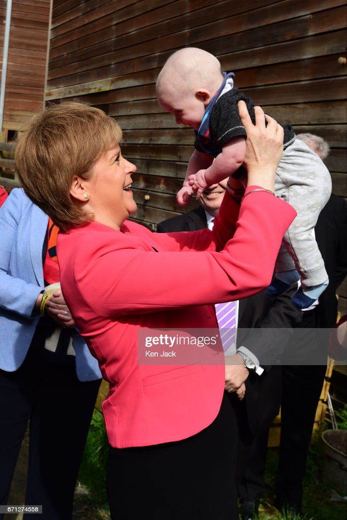 Scottish First Minister and SNP leader Nicola Sturgeon with six-month old Ollie Lynch from Edinburgh, as she launches the party's manifesto for the local government elections campaign at WHALE community arts centre, on April 21, 2017 in Edinburgh, Scotland. Local elections are scheduled to take place on Thursday May 4 across all local authorities.