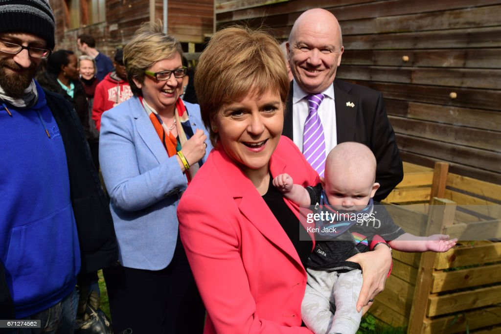 Scottish First Minister and SNP leader Nicola Sturgeon with six-month old Ollie Lynch from Edinburgh, as she launches the party's manifesto for the local government elections campaign at WHALE community arts centre, with Joanna Cherry MP and Gordon MacDonald MSP (Top R) in the background, on April 21, 2017 in Edinburgh, Scotland. Local elections are scheduled to take place on Thursday May 4 across all local authorities.