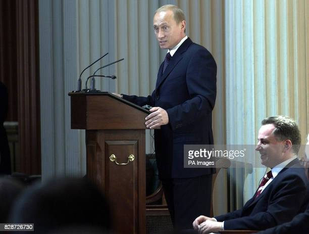 Scottish First Minister Jack McConnell listens to Russian President Vladimir Putin making a speech in the Signet Library in Edinburgh Mr Putin is...