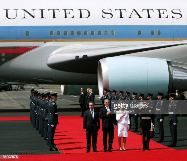 Scottish First Minister Jack McConnell stands with US President George W Bush and the first lady Laura Bush as they arrive in Prestwick Airport July...