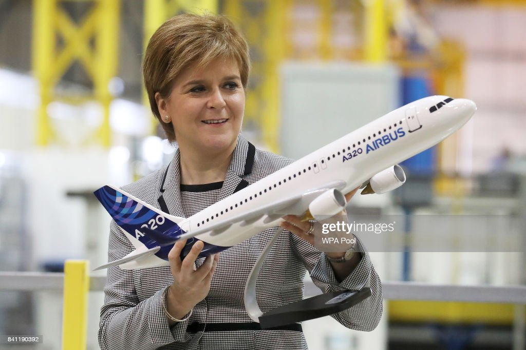 Scottish First Minister Nicola Sturgeon holds a model of an Airbus 320 after making a keynote speech on Scotland economy at Spirit Aerospace in Prestwick where she was also given a tour of the factory on August 31, 2017 in Prestwick, Scotland.
