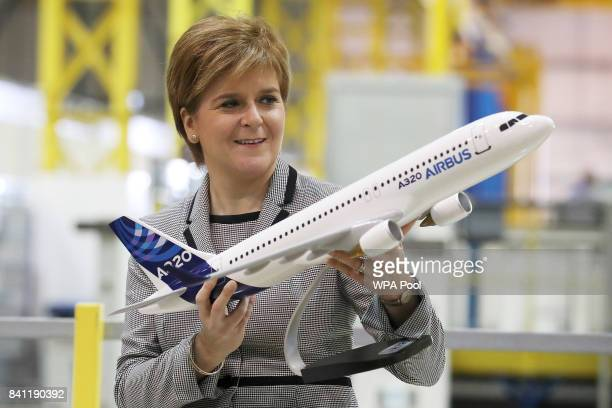 Scottish First Minister Nicola Sturgeon holds a model of an Airbus 320 after making a keynote speech on Scotland economy at Spirit Aerospace in...