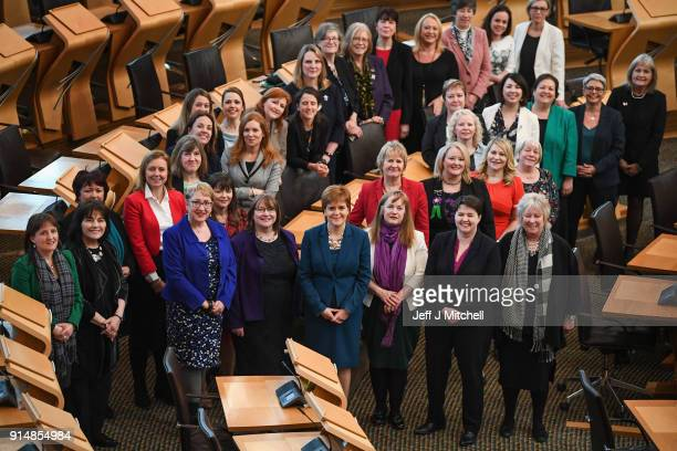 Scottish First Minister Nicola Sturgeon poses with female members of the Scottish Parliament in the main debating chamber to celebrate the centenary...