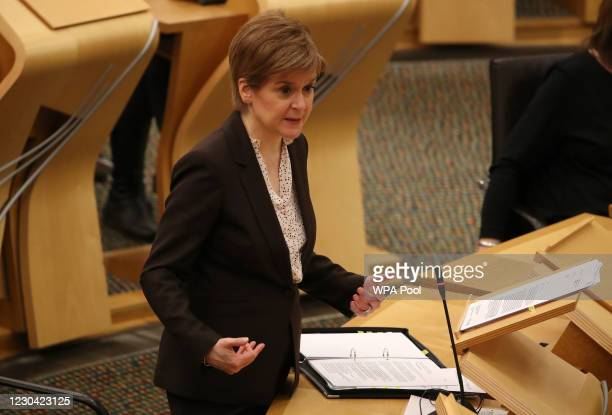 Scottish First Minister, Nicola Sturgeon reacts as she delivers a statement at Holyrood, Edinburgh, announcing that Scotland will be placed in...