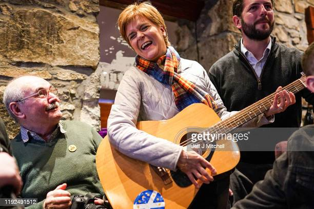 Scottish First Minister Nicola Sturgeon strums a guitar as she takes part in a traditional music workshop with Fergus Mutch SNP candidate for...