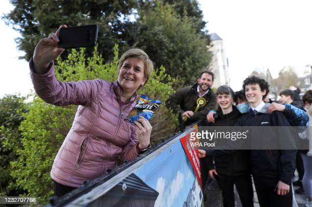 Scottish First Minister Nicola Sturgeon takes a selfie as she campaigns for the parliamentary elections on May 5, 2021 in Alford, Scotland. The...