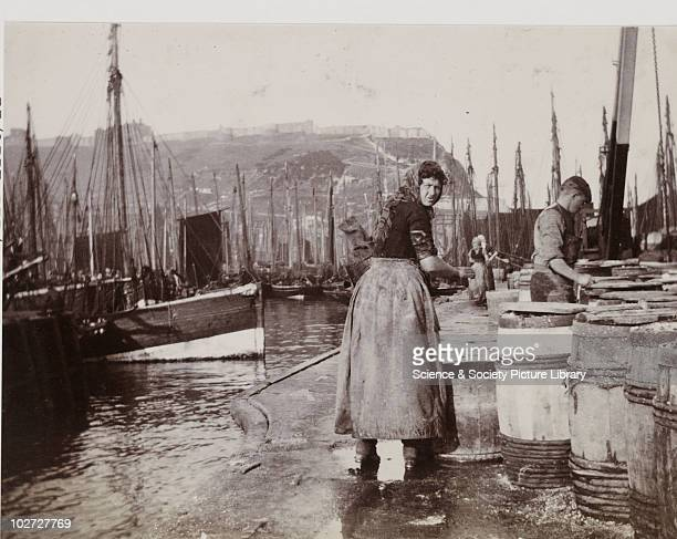 Scottish fisher girls gutting herring on Scarborough quayside c1900s Photograph by Frank Meadow Sutcliffe