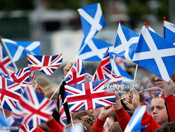 Scottish flags and Union Jacks are waved at the opening of the Borders Railway at Tweedbank Station on September 9 2015 in Tweedbank Scotland Today...