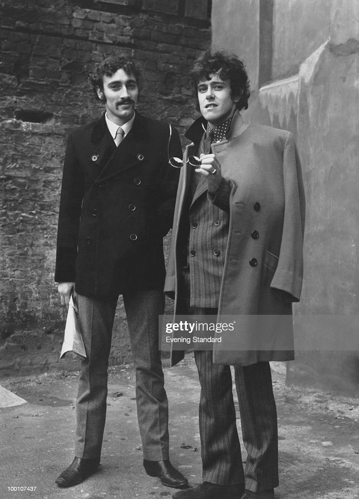 Scottish folk and pop singer-songwriter Donovan (right) with his musical director David Mills, on their way to court during a contractual dispute with their record company, 10th June 1966.