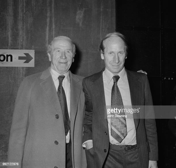 Scottish football player and manager Matt Busby and English soccer player Bobby Charlton midfielder for Manchester United FC who is about to play his...