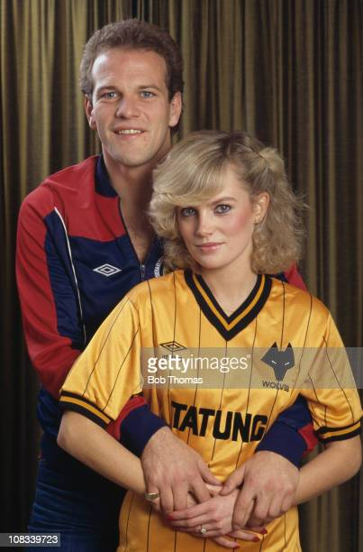 Scottish footballer and Wolverhampton Wanderers captain Andy Gray posing with Janet Gray in a Wolves shirt 27th October 1983
