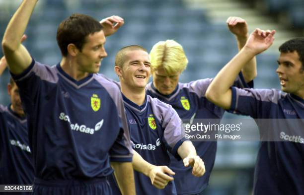 Scottish footballer Barry Ferguson centre trains with David Weir left Colin Hendry centreright and Callum Davidson right at Hampden Park in Glasgow...