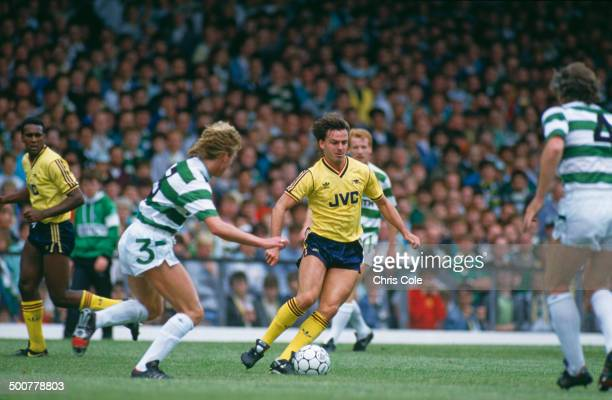 Scottish footballer Charlie Nicholas of Arsenal in action against Celtic at Celtic Park Glasgow 1st August 1987 Arsenal won the match 51