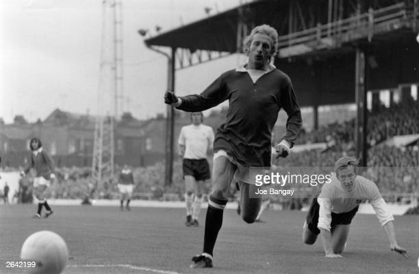 Scottish footballer Denis Law in action for Manchester United during a friendly match against Luton Town Original Publication People Disc HP0271
