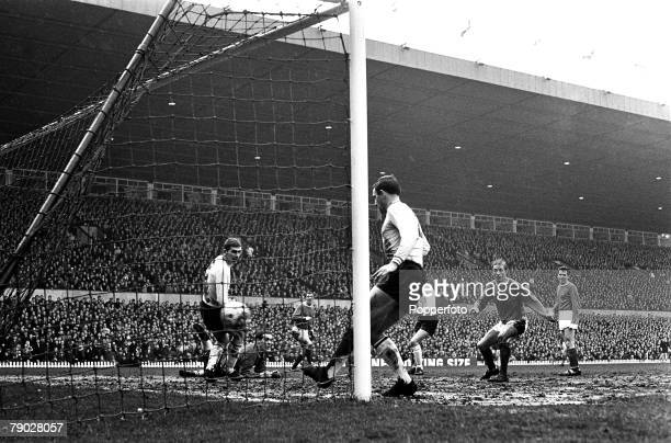 Scottish footballer Denis Law scores Manchester United's third goal against Burnley in a League Division One match at Old Trafford Manchester 24th...