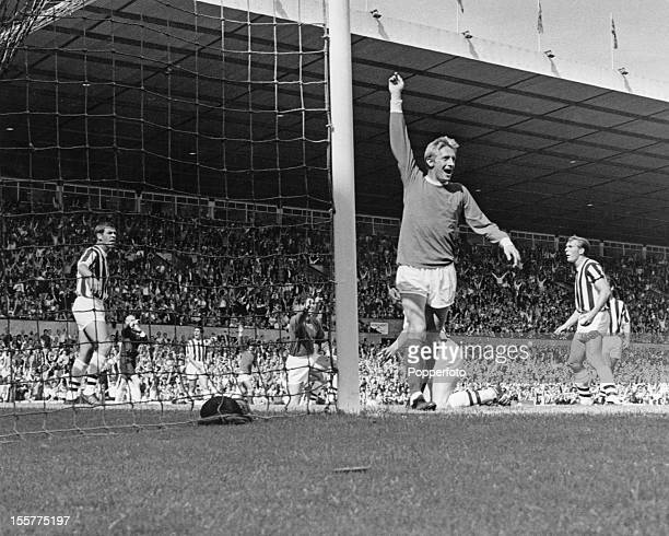 Scottish footballer Dennis Law of Manchester United celebrates after scoring a goal circa 1968