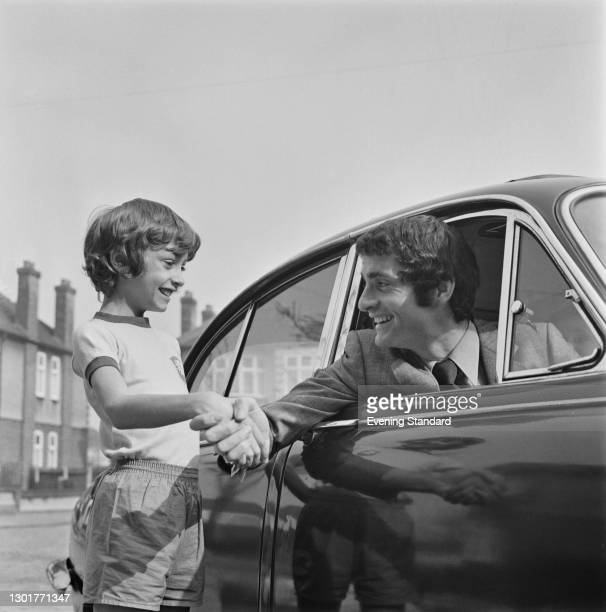 Scottish footballer Frank McLintock of Arsenal FC with his son Neil, UK, 18th March 1972.