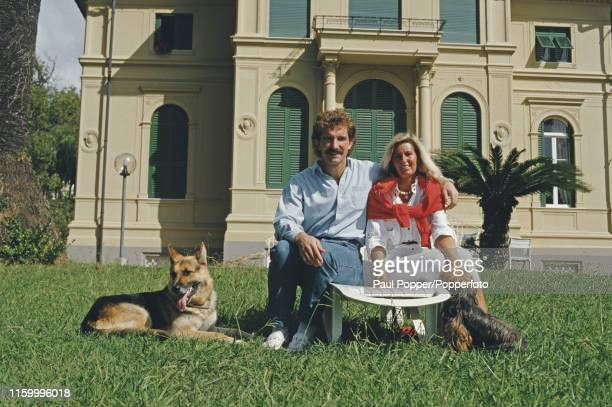 Scottish footballer Graeme Souness, midfielder with Sampdoria, pictured with his wife Danielle and dog Bruce in the garden of their house in Genoa,...