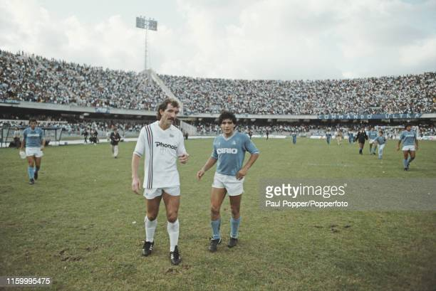 Scottish footballer Graeme Souness of Sampdoria and Diego Maradona of Napoli pictured chatting together on the pitch after playing in the Serie A...