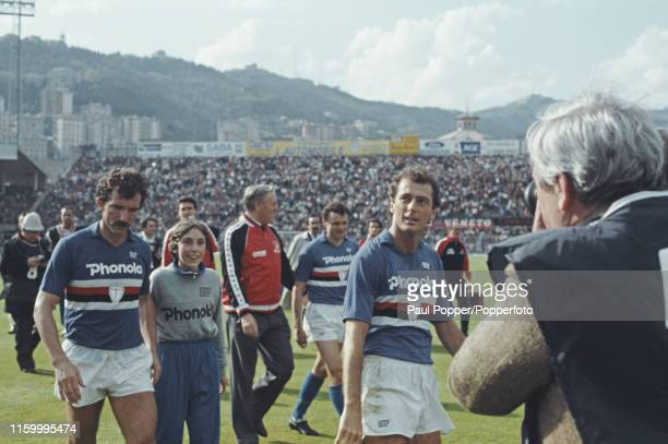 Scottish footballer Graeme Souness pictured on left with teammate Trevor Francis on the pitch after playing for Sampdoria in the Serie A match...