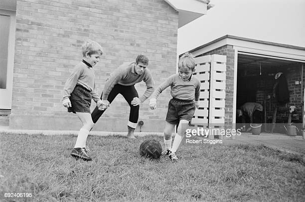 Scottish footballer Lawrie Leslie of Millwall FC playing football with his sons Guy and Grant UK 25th November 1966