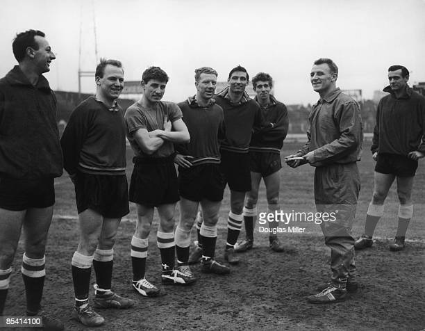 Scottish footballer Tommy Docherty chats with other Chelsea players at Stamford Bridge 13th February 1961 Docherty has just been transferred from...