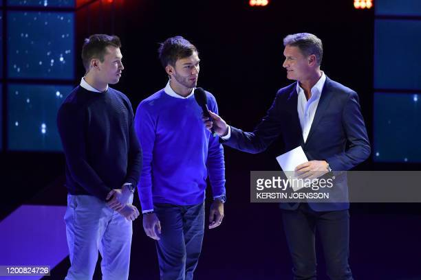 Scottish former Formula One racing driver David Coulthard speaks with Alpha Tauri's Russian driver Daniil Kvyat and Alpha Tauri's French driver...