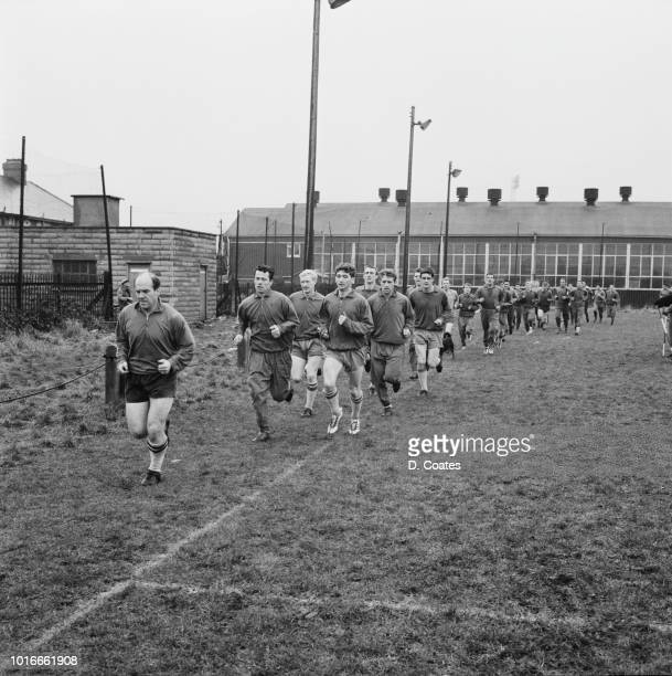 Scottish former soccer player and manager Jimmy Scoular leading Cardiff City FC soccer players during a training session UK 9th January 1965