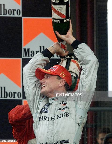 Scottish Formula One driver David Coulthard sprays champagne celebrating his Brazilian Formula One GP victory 01 April 2001 in Sao Paulo Brazil...