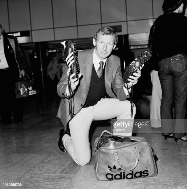 Scottish goalkeeper and broadcaster Bob Wilson showing a pair of soccer cleats from an Adidas bag UK 16th November 1983