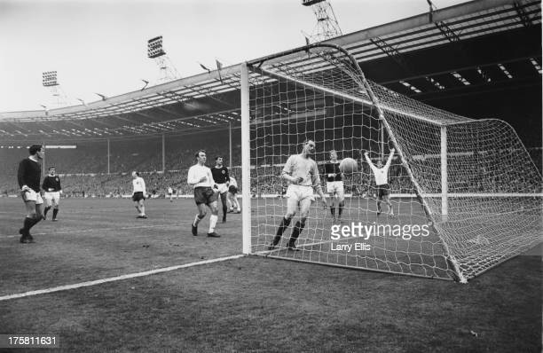 Scottish goalkeeper Ronnie Simpson fails to save a goal from Geoff Hurst during an England V Scotland match at Wembley London 15th April 1967 Also...