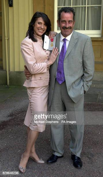 Scottish golf star Sam Torrance with his wife Suzanne Danielle after receiving his OBE from Queen Elizabeth II at Buckingham Palace London