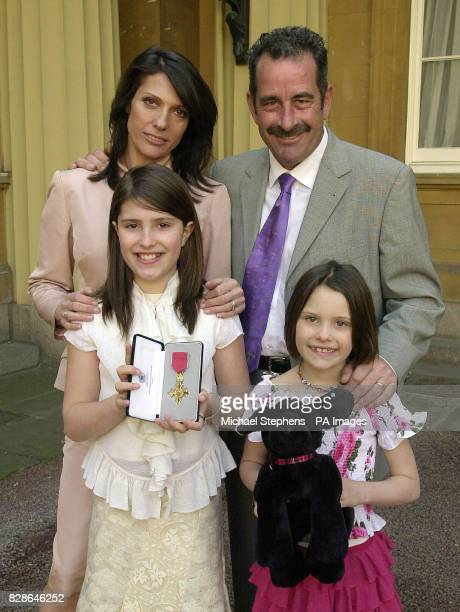 Scottish golf star Sam Torrance with his wife Suzanne Danielle and daughters Phoebe and Anouska after receiving his OBE from Queen Elizabeth II at...