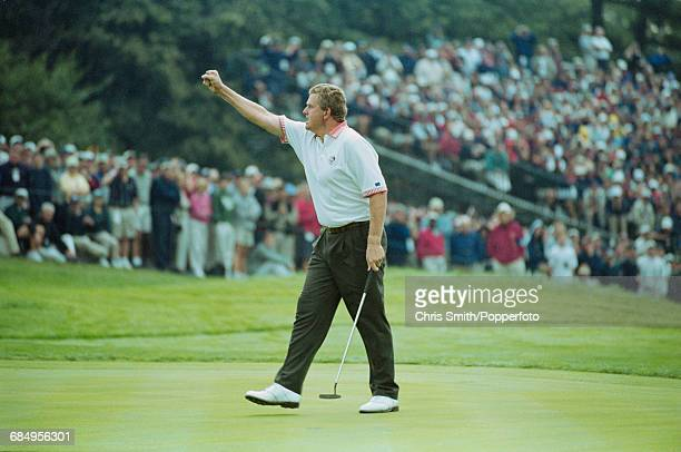 Scottish golfer Colin Montgomerie pictured celebrating after sinking a successful putt on a green for Team Europe during play to lose to Team USA in...