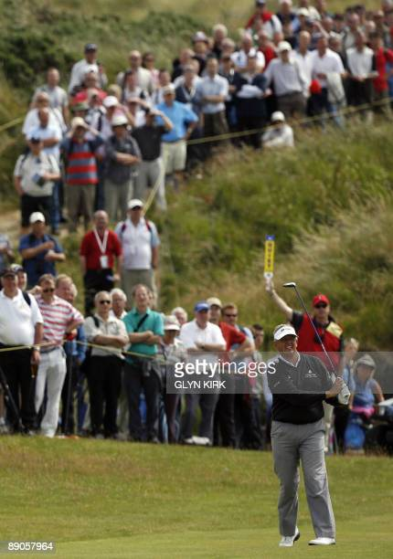 Scottish golfer Colin Montgomerie plays a shot on the 7th fairway on the first day of the 138th British Open Championship at Turnberry Golf Course in...