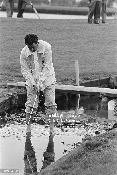 Scottish golfer Sam Torrance pictured bare footed as he stands in a stream to play a shot during action for Team Europe to win the 1985 Ryder Cup 165...