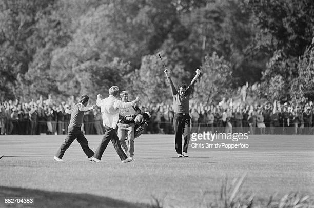 Scottish golfer Sam Torrance raises his arms in the air in celebration during play for Team Europe to win the 1985 Ryder Cup 165 115 against Team USA...