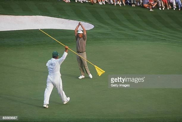 Scottish golfer Sandy Lyle celebrates his victory on the 18th hole during the final round of the Masters Tournament at Augusta National Golf Club...